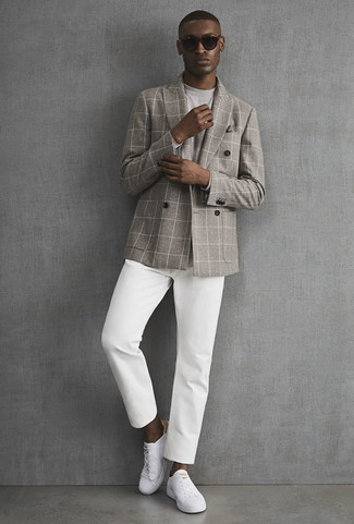 How to wear: grey check double breasted blazer, grey long sleeve t-shirt, white chinos, white leather low top sneakers