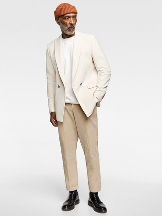How to Wear a White Long Sleeve T-Shirt For Men: Loving how well a white long sleeve t-shirt teams with khaki chinos. Dial up the formality of your ensemble a bit by slipping into black leather derby shoes.