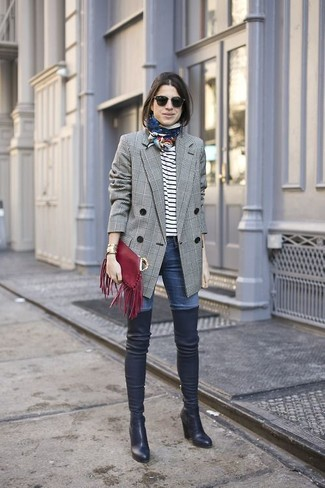 Rock a grey check double breasted blazer with blue slim jeans to bring out the stylish in you. A pair of black leather over the knee boots will seamlessly integrate within a variety of outfits.