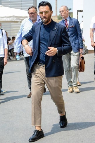 How to Wear a Navy Double Breasted Blazer For Men: A navy double breasted blazer and khaki chinos are the kind of a fail-safe outfit that you need when you have no time to spare. Complete your outfit with a pair of black leather brogues and ta-da: your look is complete.