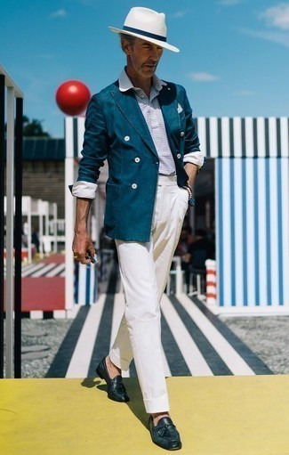 How to Wear a White and Navy Polo For Men: This combo of a white and navy polo and white dress pants is seriously stylish and creates instant appeal. Rounding off with navy leather tassel loafers is a fail-safe way to introduce some extra zing to this ensemble.