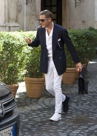 How to Wear a White Short Sleeve Shirt For Men: You'll be surprised at how easy it is for any gentleman to get dressed like this. Just a white short sleeve shirt combined with white chinos. Complement your look with a pair of white athletic shoes to easily kick up the fashion factor of your ensemble.