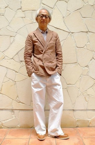 Tan Double Breasted Blazer Outfits For Men: Choose a tan double breasted blazer and white chinos for a neat elegant ensemble. Tobacco leather brogues are a great choice to round off your look.