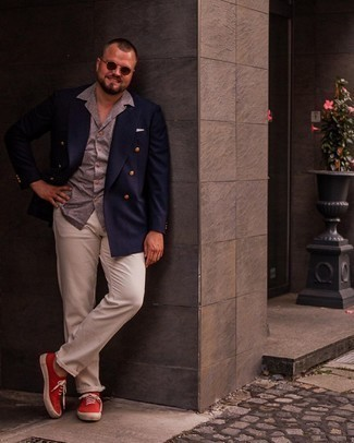 Men's Outfits 2021: A navy double breasted blazer and beige chinos make for the ultimate semi-casual look. Finishing off with a pair of red canvas low top sneakers is a surefire way to inject a touch of stylish nonchalance into this look.