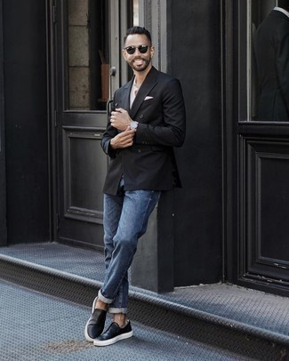 How to Wear Blue Jeans For Men: For something on the semi-casual side, you can rely on a black double breasted blazer and blue jeans. Black leather slip-on sneakers will bring a laid-back touch to this look.