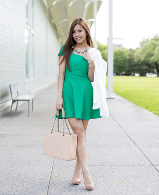 A white double breasted blazer and a green skater dress will showcase your sartorial self. Beige leather pumps will bring a classic aesthetic to the ensemble.