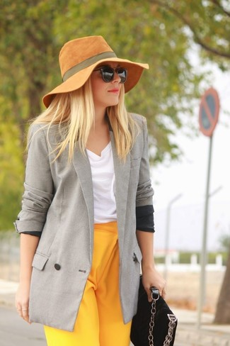 How to wear: grey double breasted blazer, white sleeveless top, yellow dress pants, black suede crossbody bag