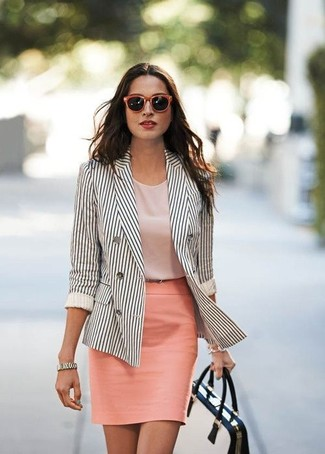 Wear a white and black vertical striped double breasted blazer and a pink pencil skirt if you're going for a neat, stylish look. So as you can see, it's a kick-ass, not to mention spring-friendly, combo to have in your transeasonal wardrobe.