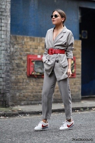 How to wear: grey double breasted blazer, grey tapered pants, white and red low top sneakers, red leather waist belt