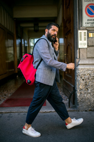 Red and Black Canvas Backpack Outfits For Men: Opt for a light blue plaid double breasted blazer and a red and black canvas backpack for comfort dressing from head to toe. Complete your getup with a pair of white and red leather low top sneakers and ta-da: the look is complete.
