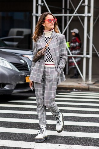 How to wear: grey plaid double breasted blazer, white and black gingham turtleneck, grey plaid dress pants, white leather lace-up flat boots