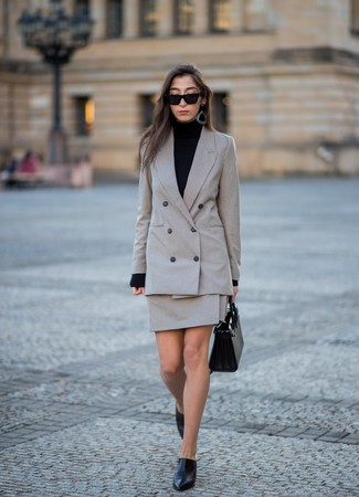 How to wear: grey check double breasted blazer, black turtleneck, grey check mini skirt, black leather mules