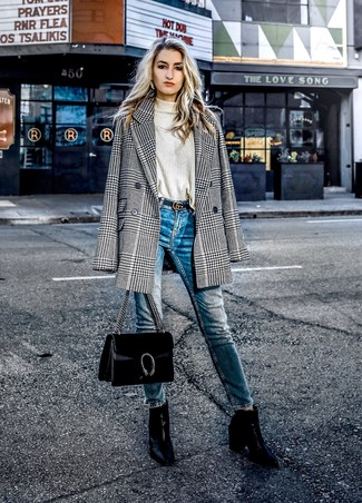 How to wear: black and white houndstooth double breasted blazer, beige turtleneck, blue skinny jeans, black leather ankle boots