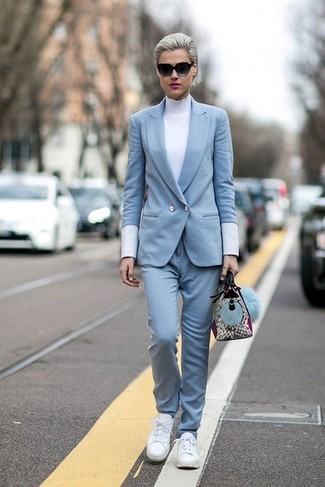 Light Blue Double Breasted Blazer Outfits For Women: If you're looking to take your casual style to a new height, pair a light blue double breasted blazer with light blue skinny pants. Jazz up this look with a more casual kind of footwear, such as this pair of white leather low top sneakers.