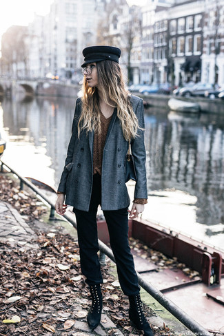 How to wear: grey double breasted blazer, gold v-neck sweater, black skinny pants, black suede lace-up flat boots