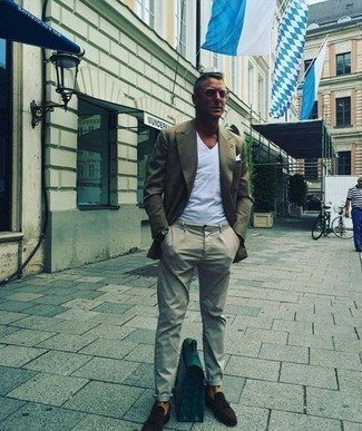 Men's Looks & Outfits: What To Wear In 2020: This pairing of an olive double breasted blazer and beige chinos is a fail-safe option when you need to look dapper in a flash. Dark brown suede tassel loafers will infuse an air of elegance into an otherwise utilitarian ensemble.