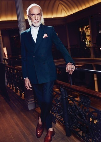 Fashion for Men Over 60: What To Wear: Pairing a dark green double breasted blazer and navy dress pants will hallmark your sartorial chops. Infuse a more casual finish into your outfit with brown leather oxford shoes.