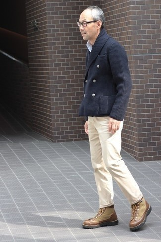 Khaki Chinos Spring Outfits: This pairing of a navy double breasted cardigan and khaki chinos is hard proof that a safe off-duty outfit doesn't have to be boring. Complement your ensemble with a pair of tan canvas work boots to give a dose of stylish casualness to your getup. So if you're on the lookout for an ensemble that's on-trend but also totally spring-ready, you found it.