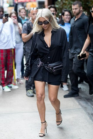 How to wear: black dress shirt, black bike shorts, black leather heeled sandals, black leather fanny pack