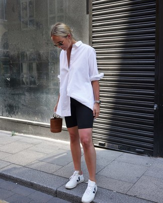 How to wear: white dress shirt, black bike shorts, white leather low top sneakers, brown leather bucket bag