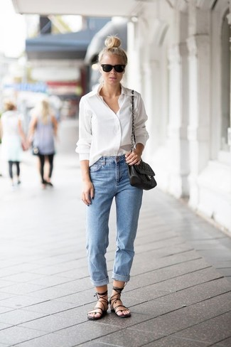 Master the effortlessly chic look in a white dress shirt and light blue  boyfriend jeans.
