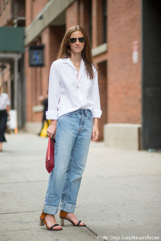 Look totally stylish without really trying in a white dress shirt and light blue boyfriend jeans. Throw in a pair of black and tan leather heeled sandals to va-va-voom your outfit. Totally summer-friendly, you can wear a variation of this getup throughout the season.