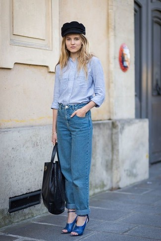 How to wear: light blue chambray dress shirt, blue boyfriend jeans, blue leather heeled sandals, black leather tote bag
