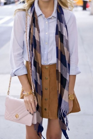 This pairing of a light blue dress shirt and a button skirt is simple, totally stylish and oh-so-easy to recreate! We're loving that this look is great come warmer weather.