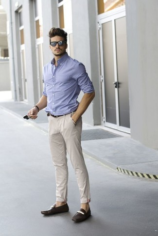 Marry a light blue check classic shirt with beige casual pants if you're going for a neat, stylish look. This outfit is complemented perfectly with dark brown leather loafers.