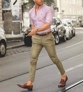This combination of a pink vertical striped dress shirt and khaki chinos will set you apart effortlessly. Round off your outfit with Alden men's Leather Penny Loafers. A kick-ass look like this one is just what you need on a hot weather day.