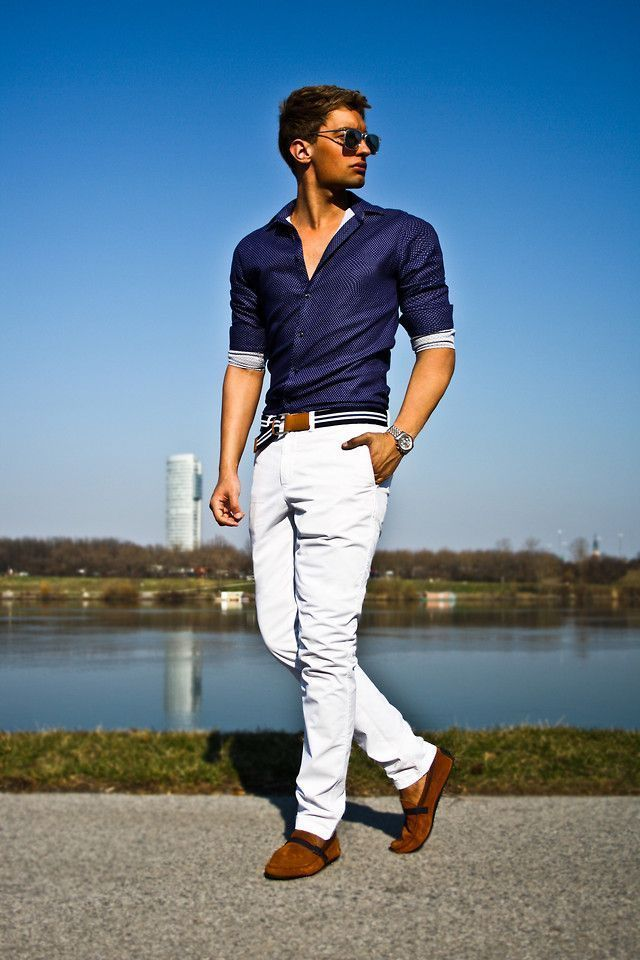This combo of a dark blue chambray classic shirt and white casual pants  will add a