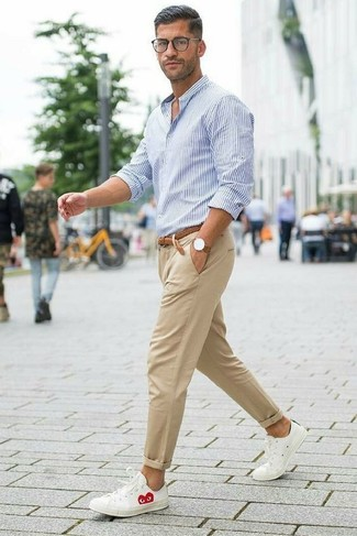 How to wear: white and blue vertical striped dress shirt, khaki chinos, white leather low top sneakers, brown woven leather belt