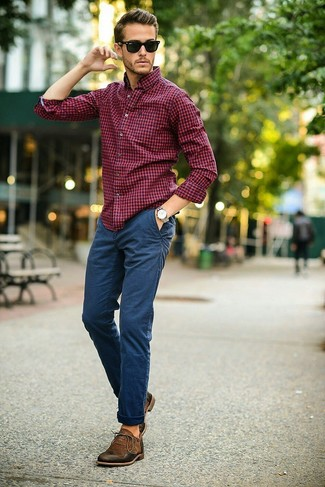 How to wear: red and navy gingham dress shirt, navy chinos, dark brown leather oxford shoes, black sunglasses