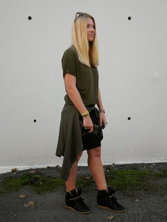 Busy days call for a simple yet stylish outfit, such as an olive crew-neck t-shirt and a black mini skirt. Complement this ensemble with black suede wedge sneakers. This getup is ideal for weird fall weather.