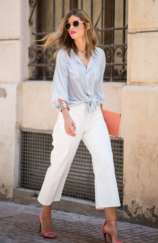 How to wear: light blue vertical striped dress shirt, white culottes, orange leather heeled sandals, orange leather clutch