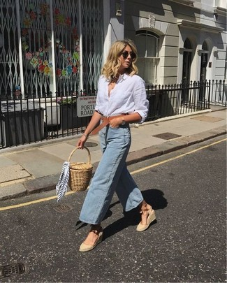Light Blue Denim Culottes Outfits: Putting together a white linen dress shirt with light blue denim culottes is a savvy choice for a relaxed casual getup. Slip into a pair of beige canvas wedge sandals and you're all done and looking smashing.