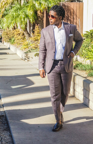 How to Wear Black Leather Loafers For Men: Choose a white dress shirt and brown linen dress pants for seriously sharp attire. Black leather loafers will add a laid-back touch to an otherwise sober ensemble.