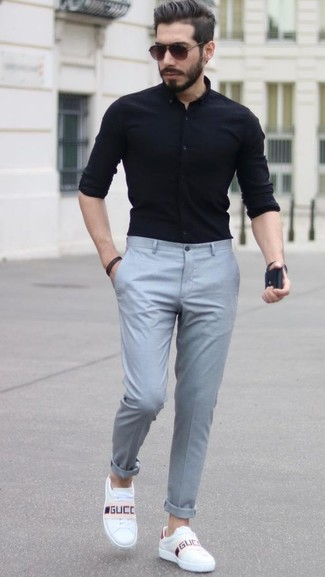 How to wear: black dress shirt, grey dress pants, white leather low top sneakers, dark brown sunglasses