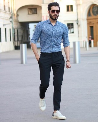How to wear: blue floral dress shirt, black dress pants, white leather low top sneakers, dark brown sunglasses