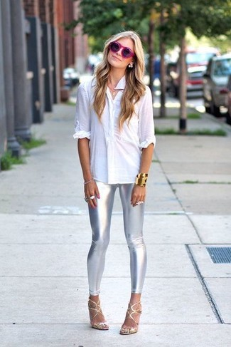 Consider pairing a white button shirt with silver leggings for a casual level of dress. Let's make a bit more effort now and throw in a pair of silver leather heeled sandals.