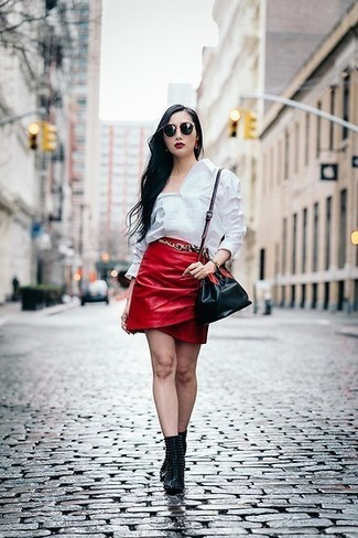 How to wear: white dress shirt, red leather mini skirt, black studded leather ankle boots, black leather bucket bag