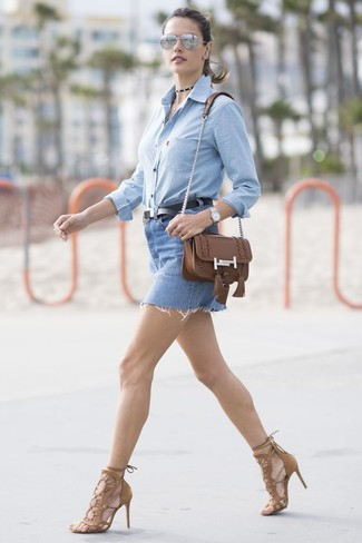 How to wear: light blue chambray dress shirt, blue denim mini skirt, brown suede heeled sandals, brown leather crossbody bag