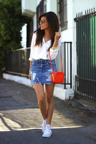 Consider wearing a white button-up shirt and a blue destroyed denim mini skirt and you'll look like a total babe. Why not add white high top sneakers to the mix for a more relaxed feel?