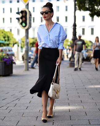 How to Wear a Light Blue Dress Shirt For Women: Infuse personality into your daily routine with a light blue dress shirt and a black ruffle pencil skirt. Black and tan leather pumps round off this ensemble quite nicely.