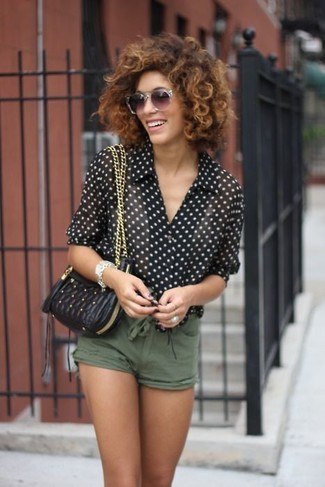 How to wear: black and white polka dot chiffon dress shirt, olive shorts, black quilted leather crossbody bag, grey sunglasses