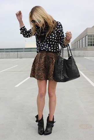 Black Polka Dot Dress Shirt Outfits For Women: This relaxed combination of a black polka dot dress shirt and a brown leopard skater skirt is extremely easy to throw together in no time flat, helping you look chic and ready for anything without spending too much time rummaging through your wardrobe. Let your styling expertise really shine by rounding off this look with black leather ankle boots.