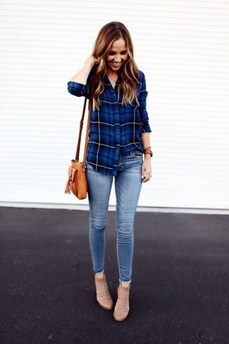 How to Wear Light Blue Skinny Jeans: Teaming a blue plaid dress shirt with light blue skinny jeans is a nice idea for a casual getup. A pair of beige suede ankle boots is a wonderful option to finish your ensemble.