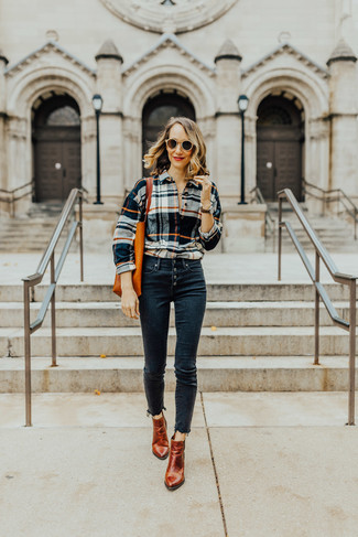 How to wear: multi colored plaid dress shirt, navy skinny jeans, tobacco leather ankle boots, orange leather tote bag