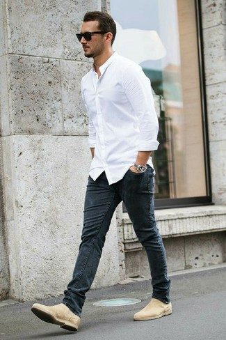 How to wear: white dress shirt, charcoal skinny jeans, beige suede chelsea boots, black sunglasses