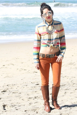 Consider teaming a multi colored horizontal striped dress shirt with orange skinny jeans for an easy to wear look. Elevate your getup with brown leather knee high boots.